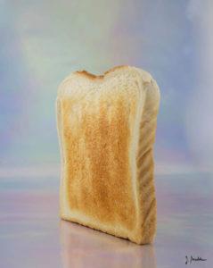 Ein Toastbrot steht vor fluoreszierendem Hintergrund.